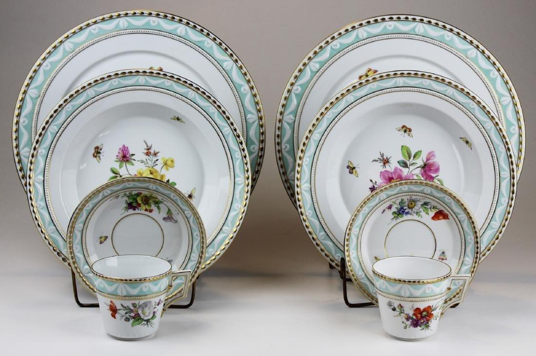 Two KPM Kurland porcelain place settings