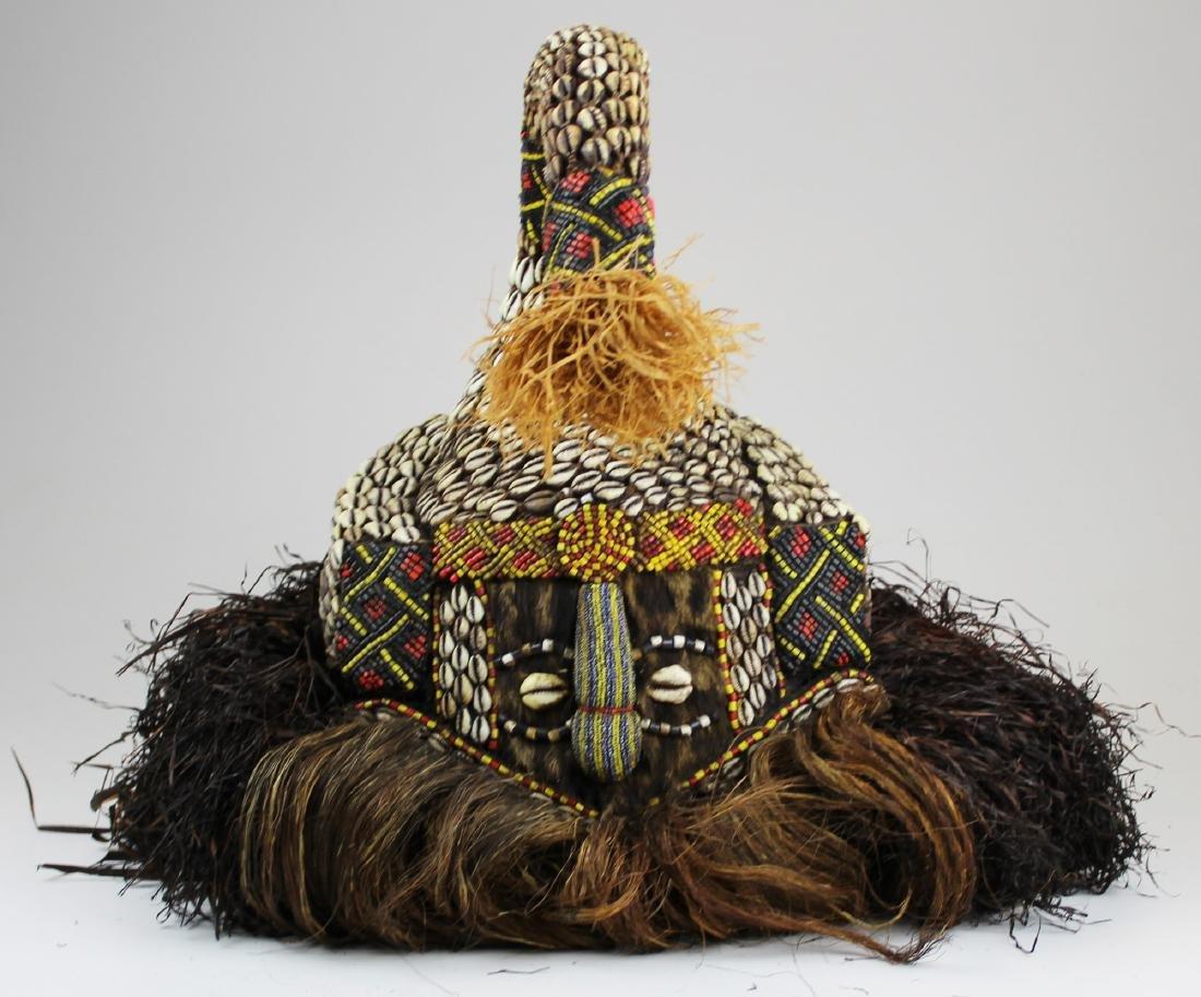 "mid 20th c African Kuba ""mukenga"" mask"