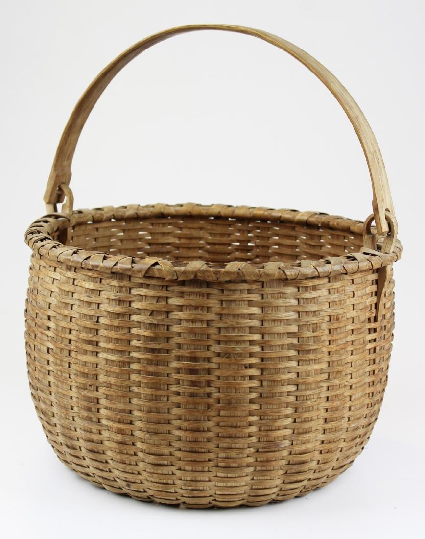 late 19th c Taconic, NY swing handled basket
