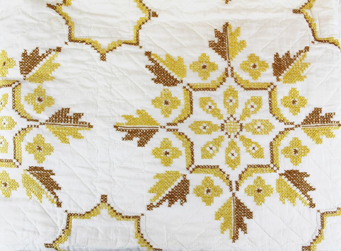 20th c cross stitch decorated quilt