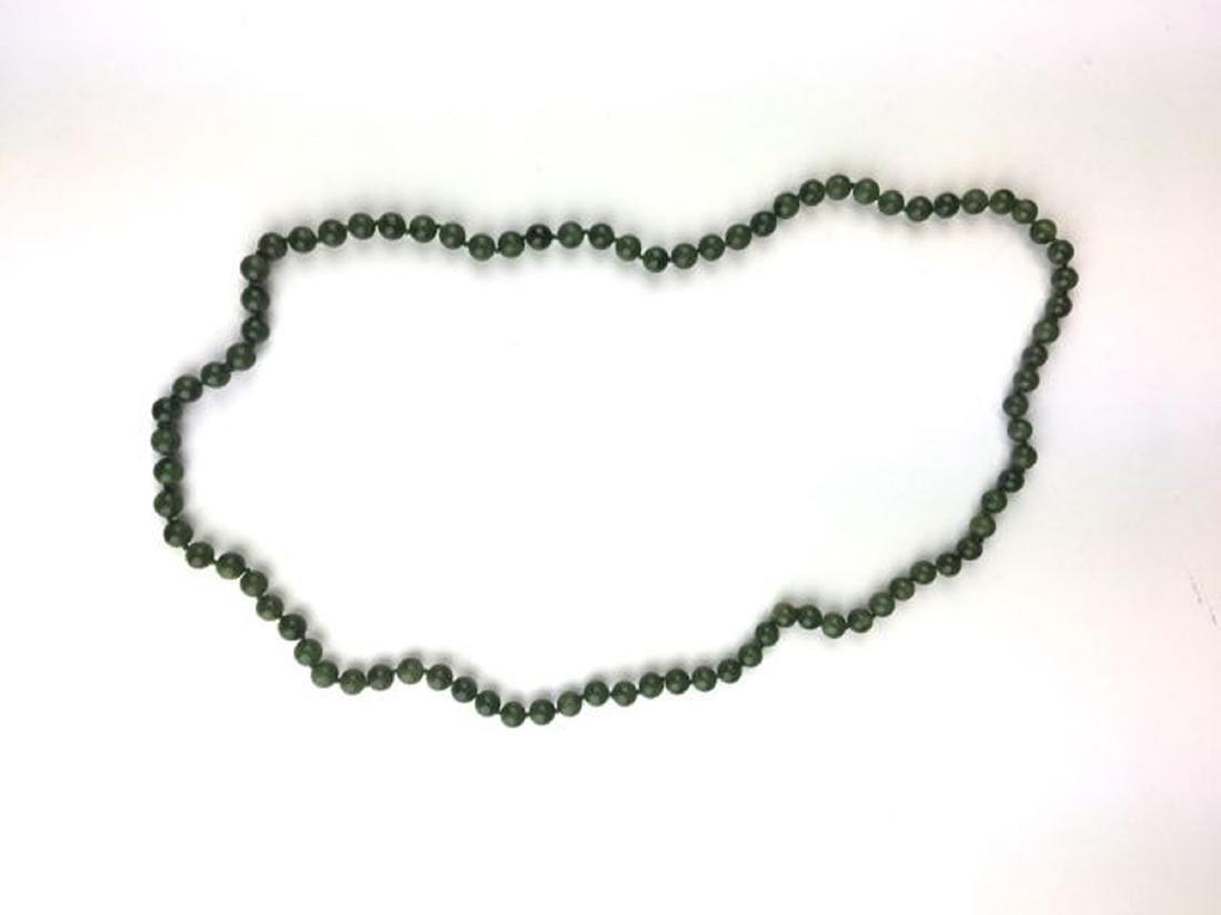 Deep green jade bead necklace.