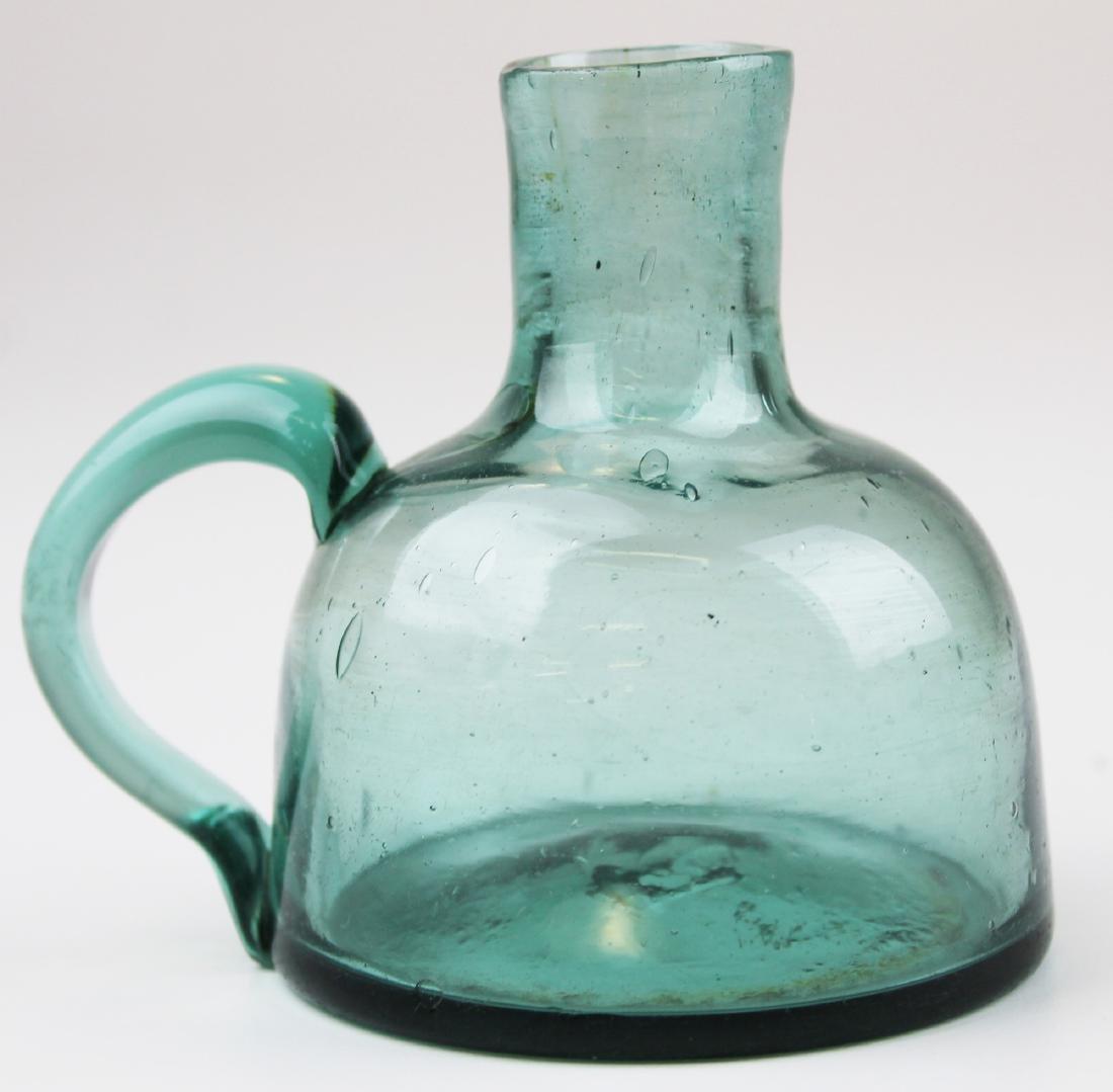early 19th c aqua free-blown glass sparking lamp