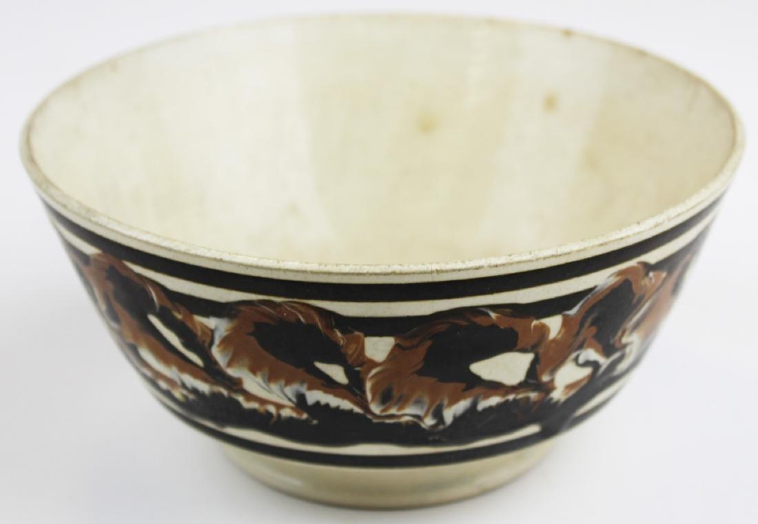 Mocha earth worm bowl decorated bowl.