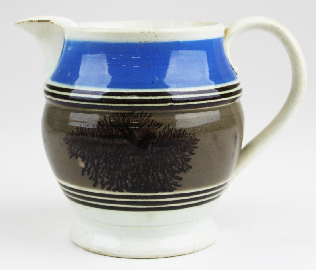 Mocha dendritic decorated pitcher.