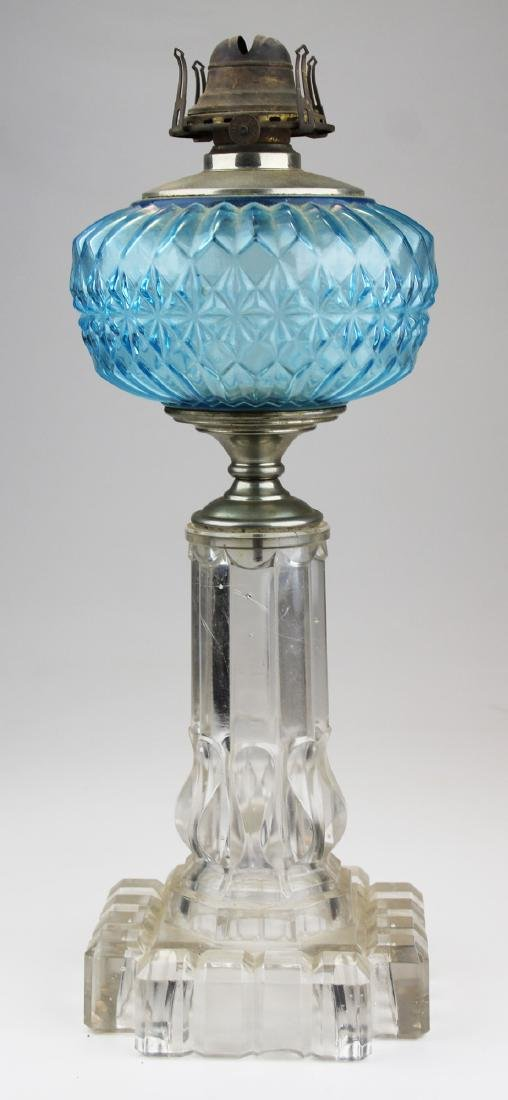 "16"" high clear & blue pattern glass oil lamp"