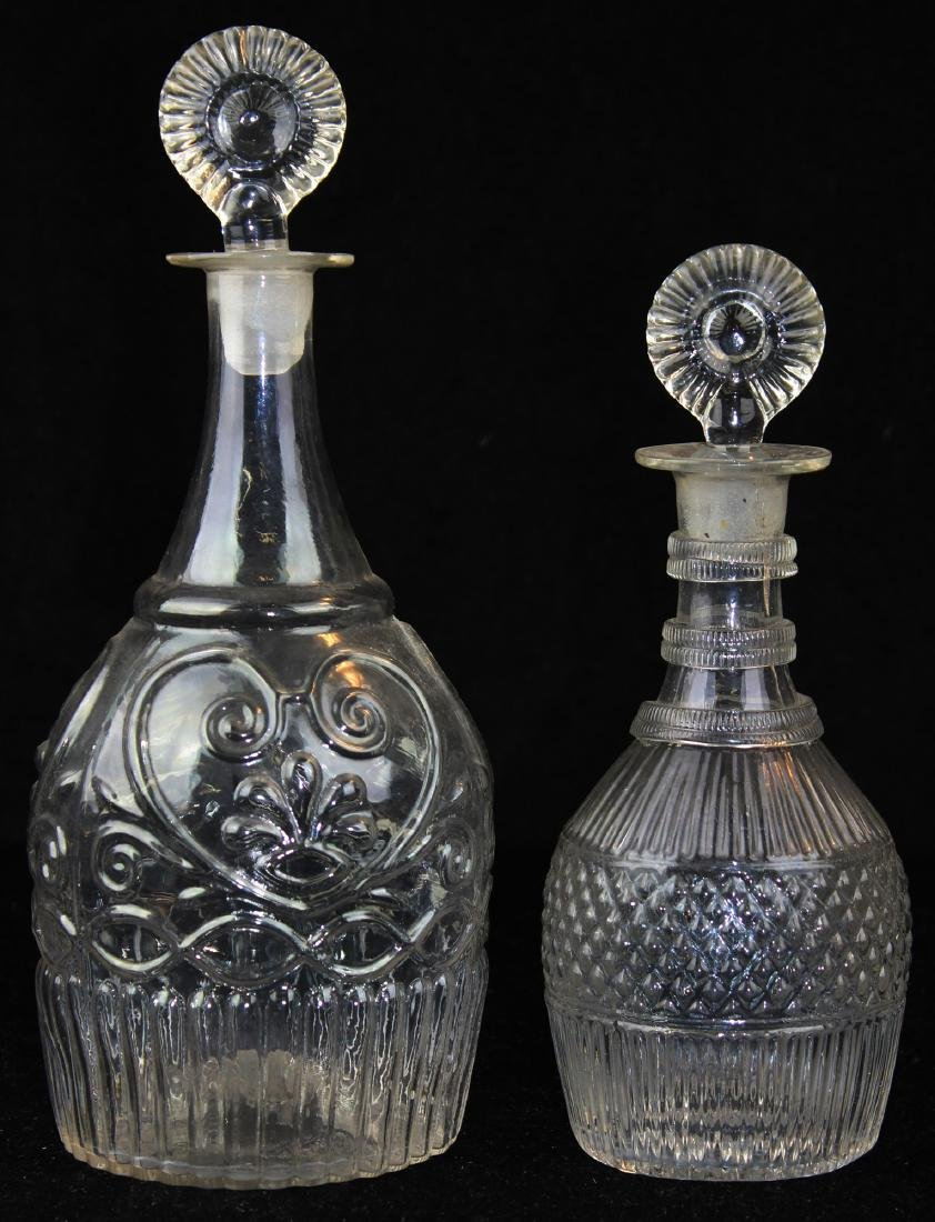 two early 19th c blown three mold decanters