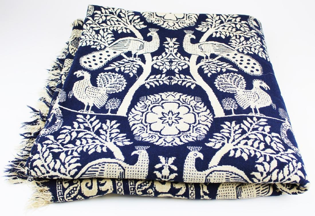 mid 19th c blue & white coverlet with peafowl