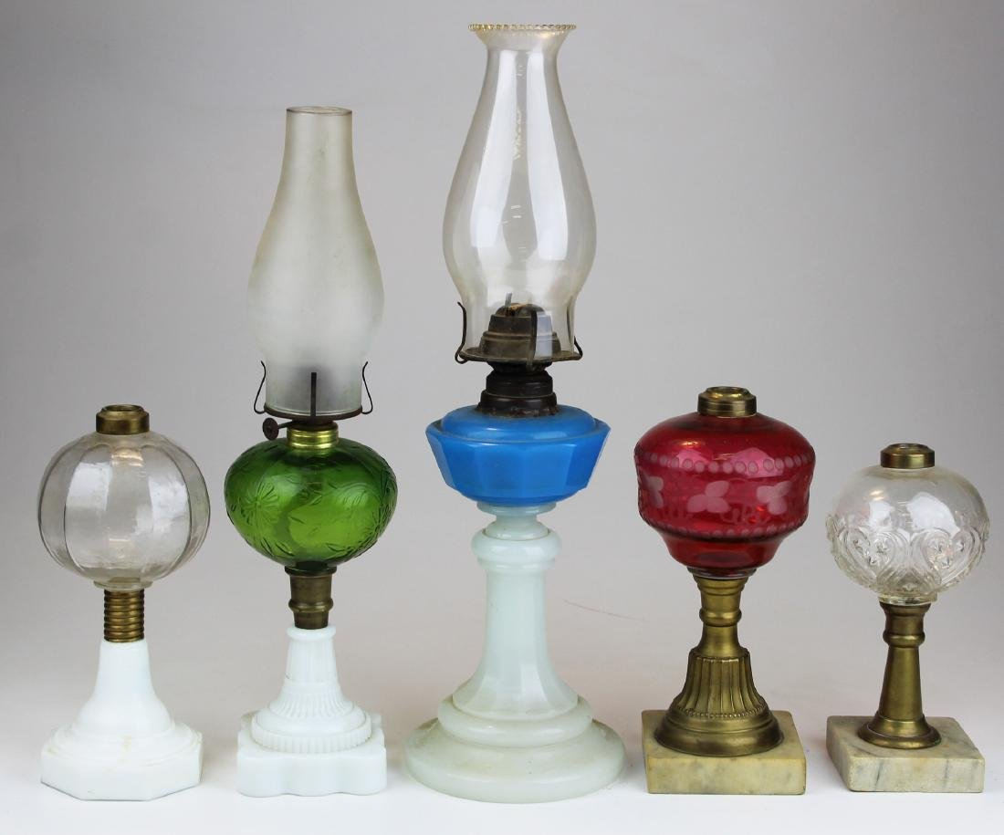 A group of 5 oil lamps