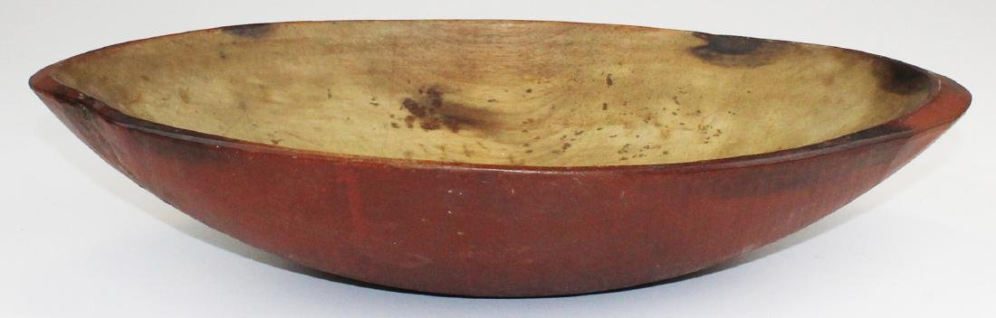 mid 19th c trencher bowl in old red paint