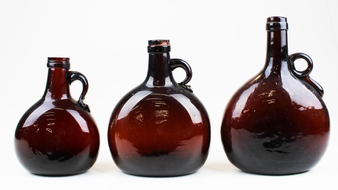 three ca 1850's chestnut whiskey bottles