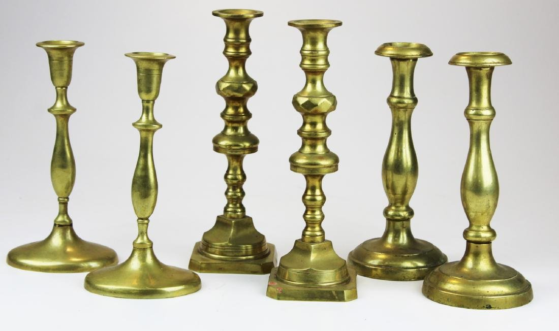 three pair of heavy brass candlesticks