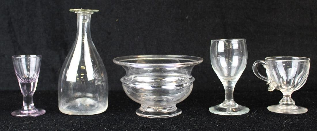 six pieces of early free-blown glass