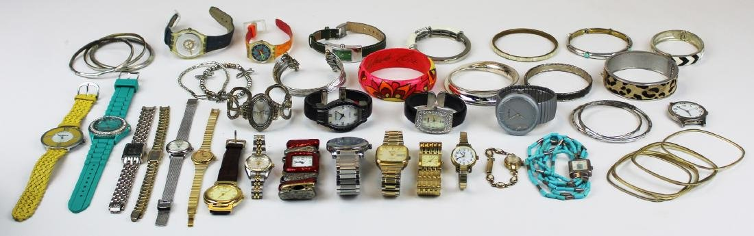lot of women's wrist watches and bangle bracelets