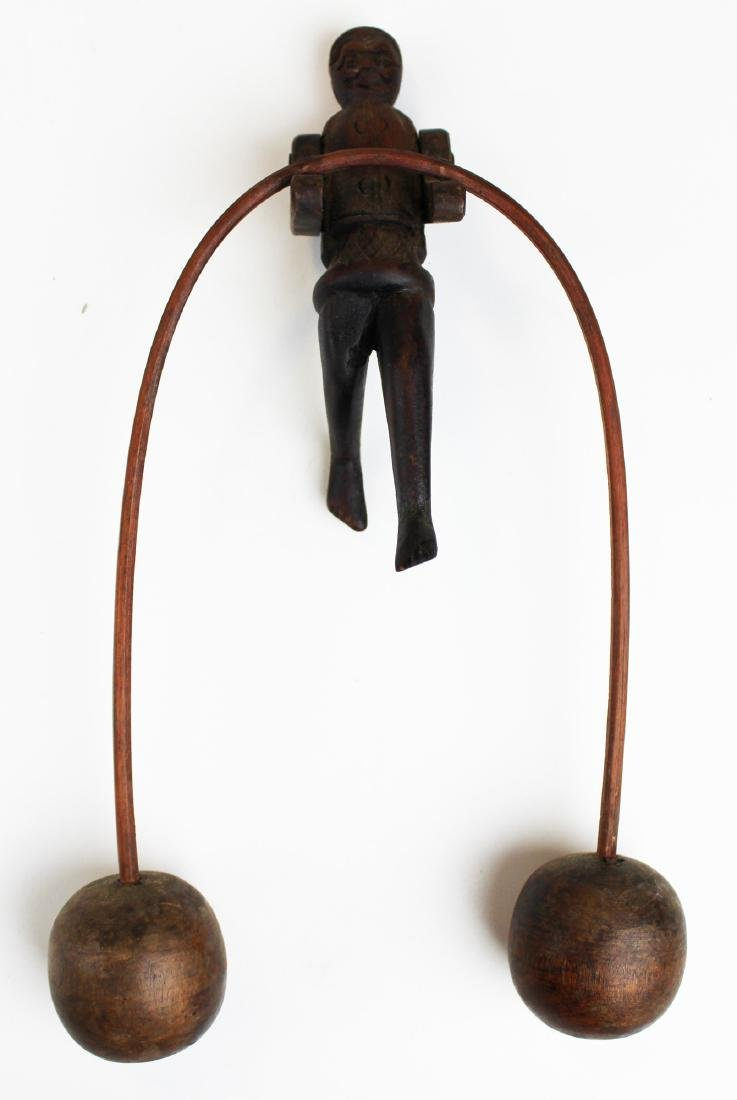 early 20th c balancing toy acrobat