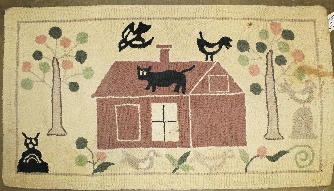 folky mid 20th c hooked rug with cat on roof