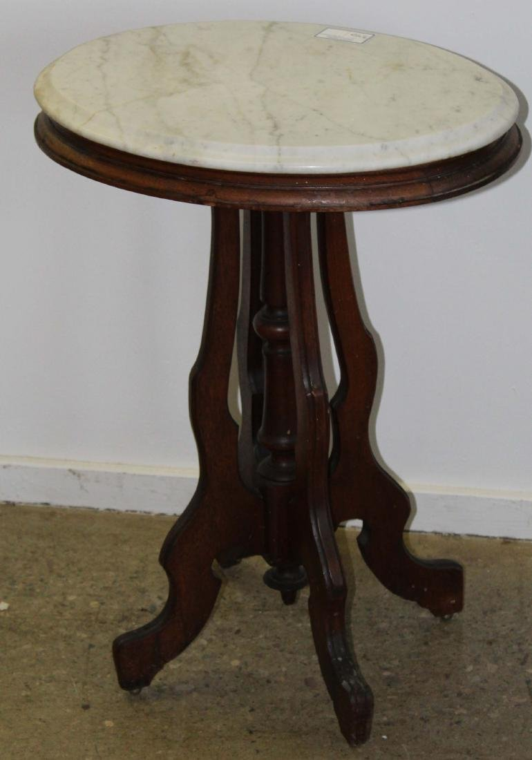Victorian oval black walnut marble top table
