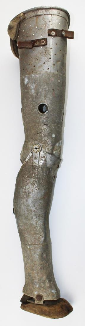 Late 19thc or early 20th tin prosthetic leg