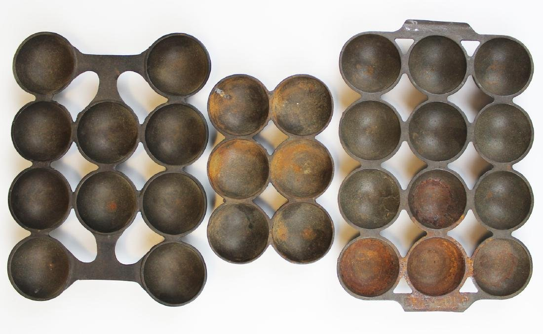 three cast iron popover pans including Griswold