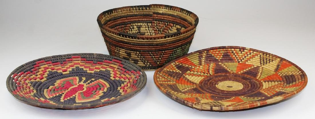 three 20th c African baskets