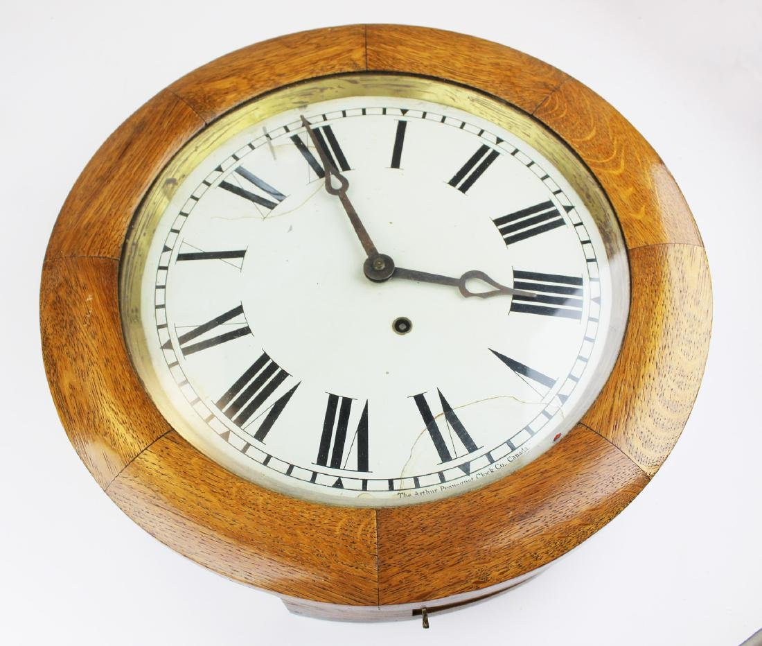 Arthur Pequegnat round oak regulator clock