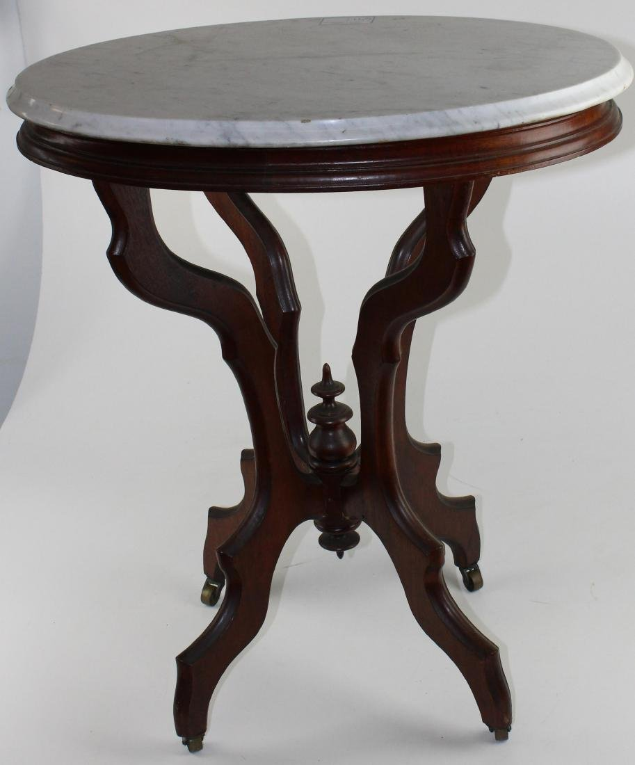 Victorian black walnut oval marble top table