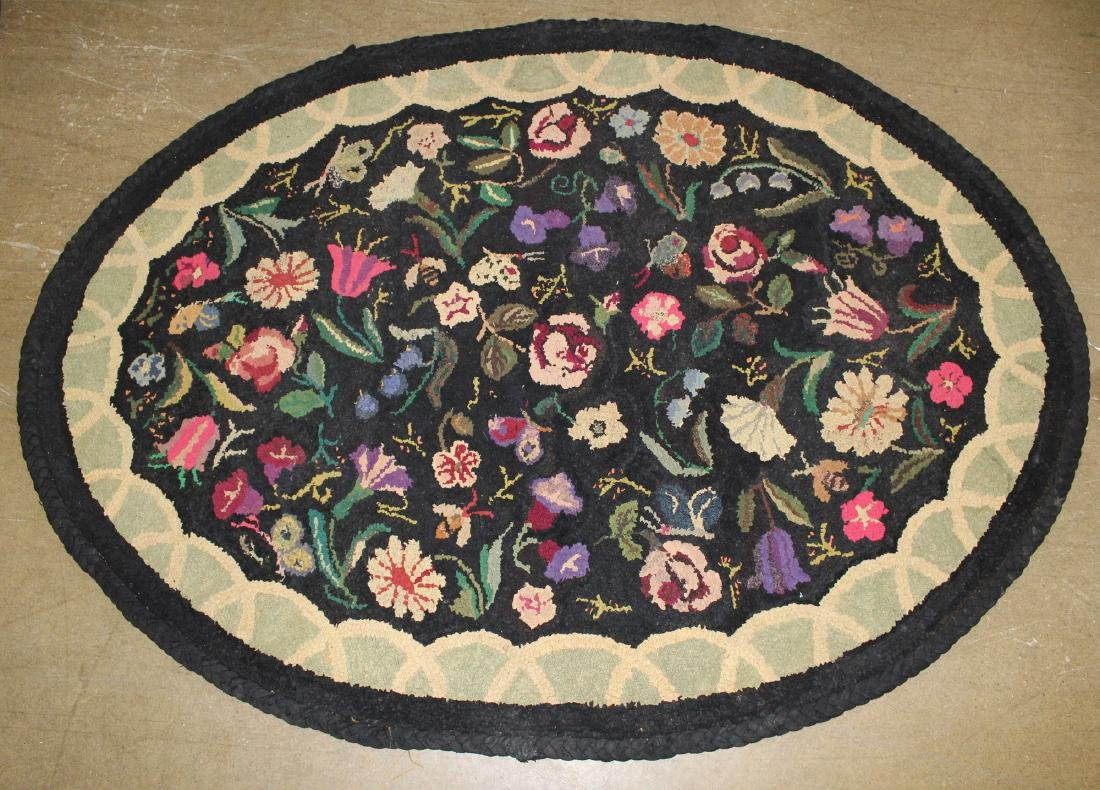 early 20th c oval floral hooked rug