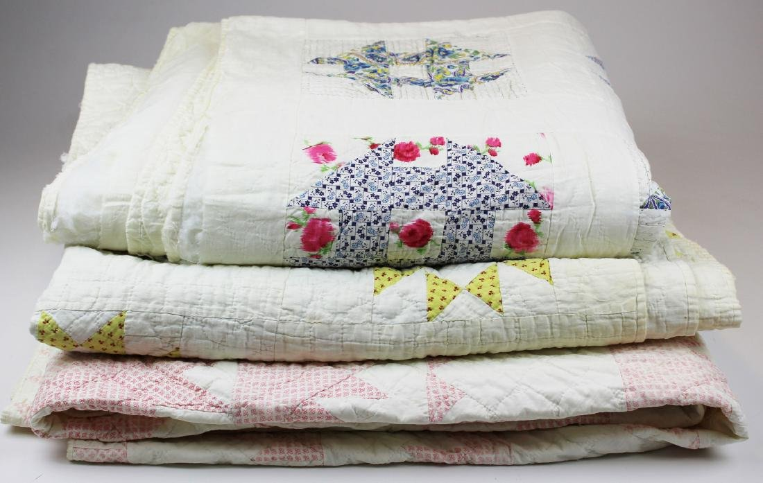 three early 20th c pieced quilts