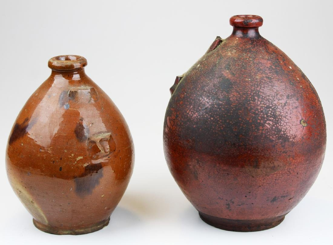two early redware ovoid jugs missing handles