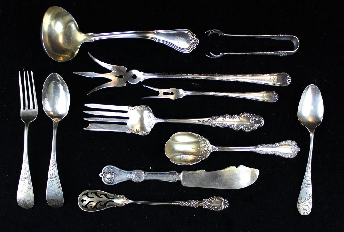 11 pcs. Ornate sterling silver flatware