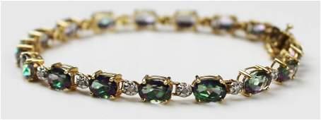 10k y g diamond  topaz tennis bracelet
