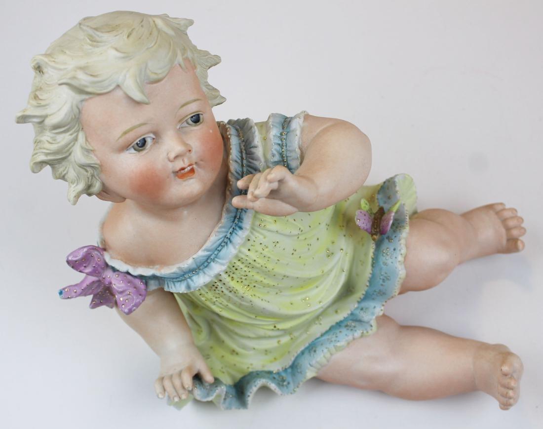 German Bisque porcelain piano baby figure