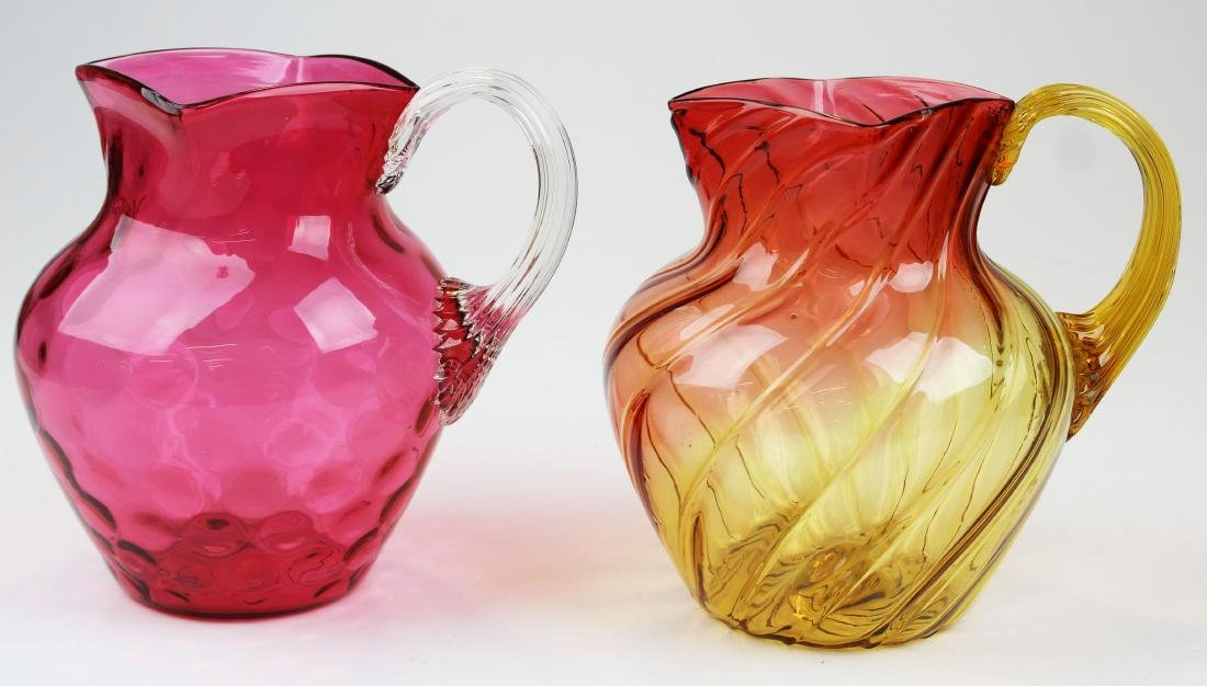 Cranberry and Amberina art glass pitchers