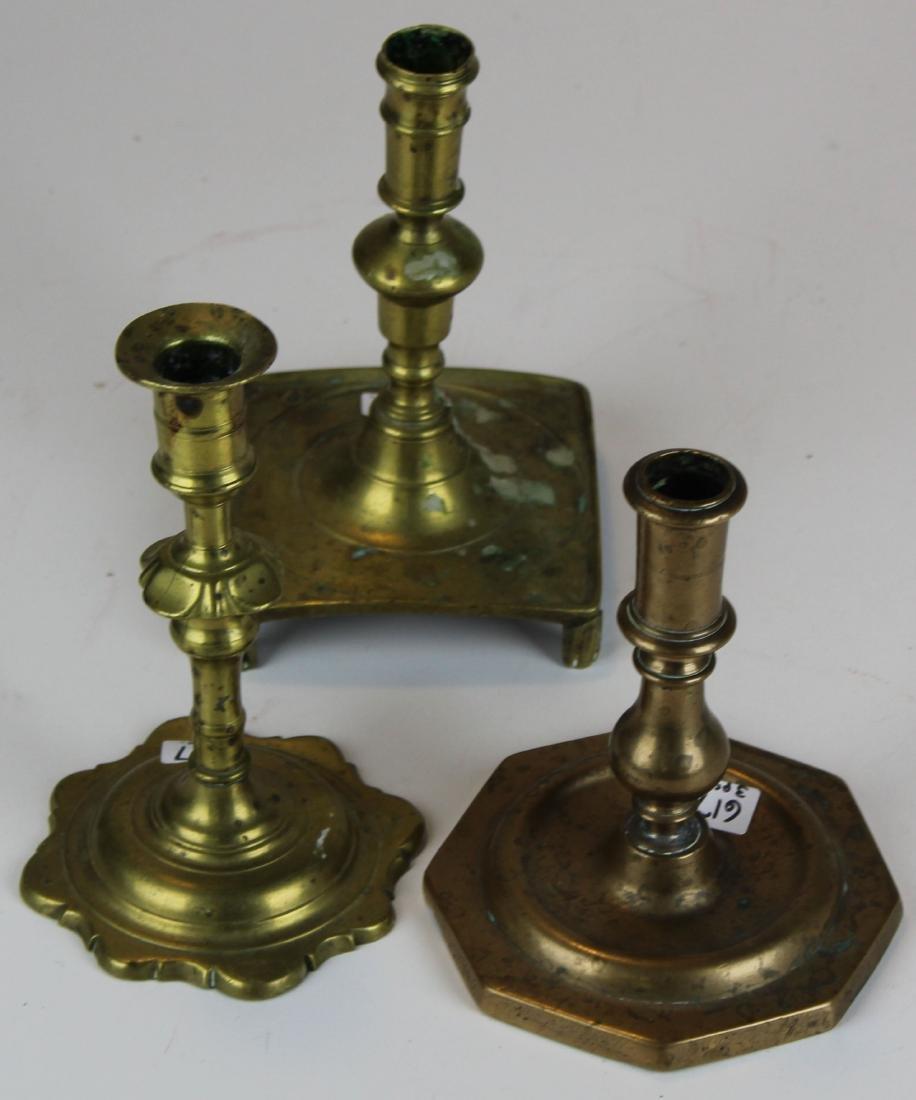 three 18th- early 19th c brass candlesticks