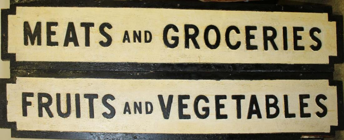 Two wooden country store signs