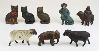 eight animal & figural cast iron still banks