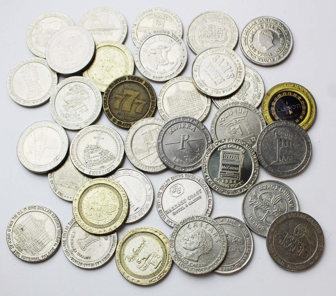 33 Las Vegas slot machine $1 dollar tokens