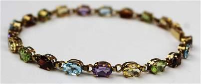 10 k y.g & multi stone tennis bracelet