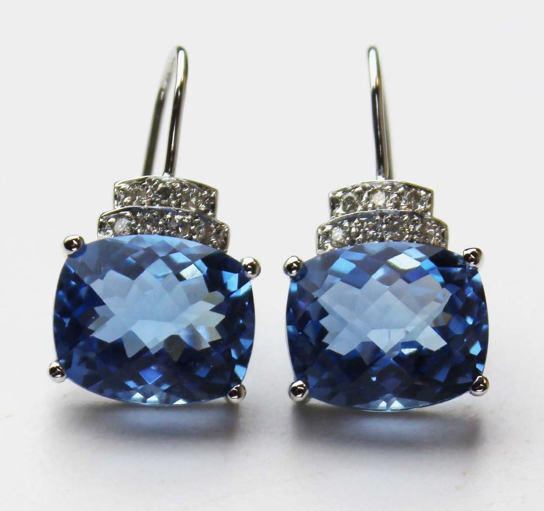 Pair of 7 ct blue topaz and diamond earrings