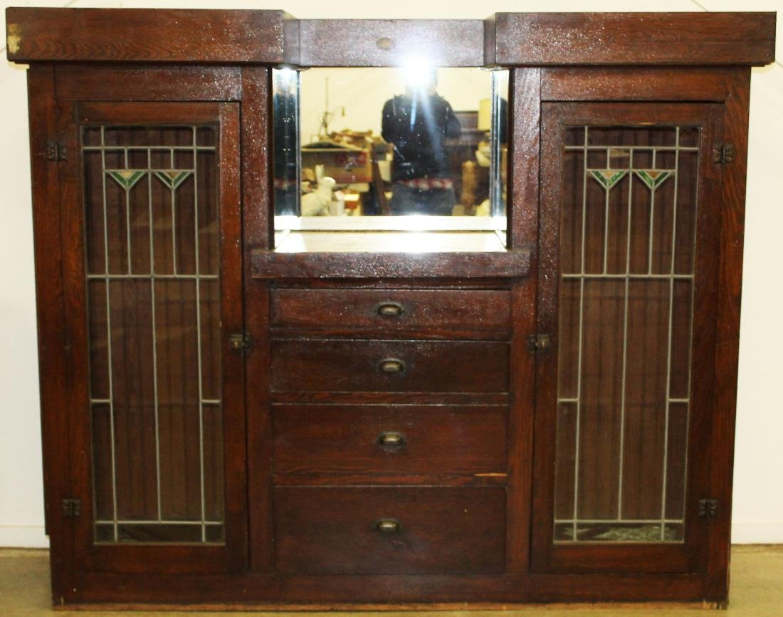 Arts and Crafts style sideboard with leaded doors