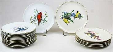 Two sets of bird decorated plates.