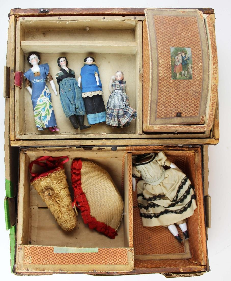doll trunk with china head dolls- as found