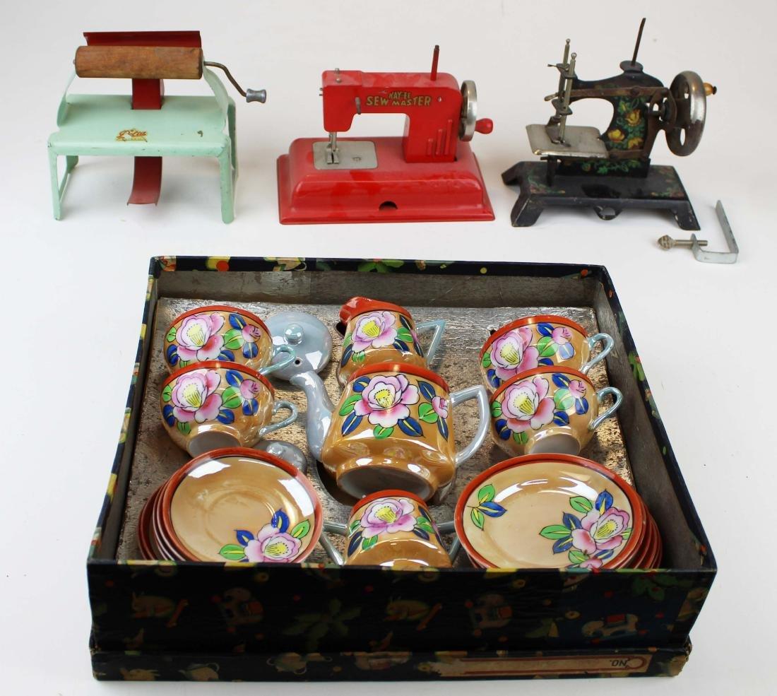 doll sewing machines, mangle, tea set