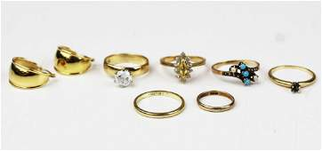 A group of yellow gold rings and earrings