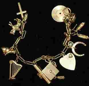 10k charm bracelet with 14k charms