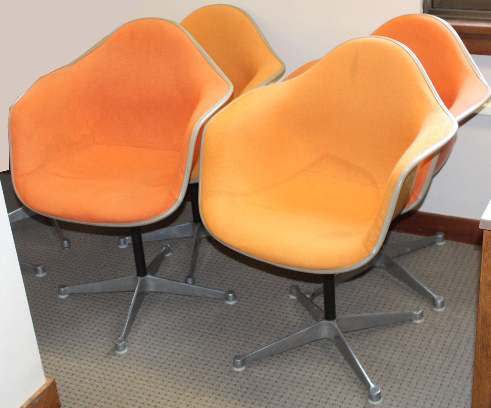 Four Orange Herman Miller Shell Chairs