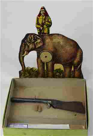 vintage elephant target game with toy rifle