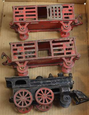 early cast iron steam locomotive & two cars