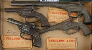 four early Kilgore, National, American cap pistols