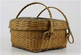 Native American double swing handled covered basket