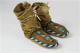 early 20th c child's Native American moccasins